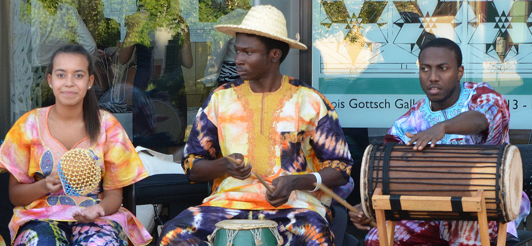 Musicians playing traditional African percussion instruments