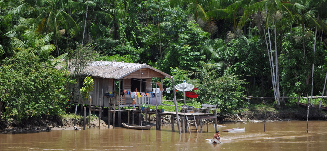 Family living on the Amazon river bank